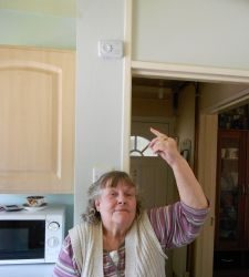 Pauline Smith with the FireAngel carbon monoxide alarm that alerted her to the deadly gas leaking from her neighbours' flat below. (Photo courtesy of The Romford Recorder)